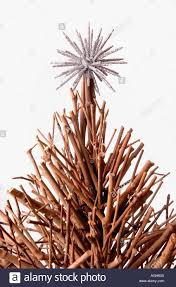wooden christmas tree made of twigs with silver spiky decoration