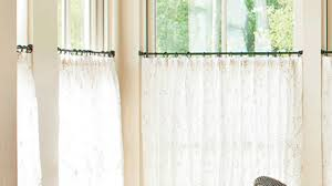 Should Curtains Touch The Floor Or Window Sill How To Hang Café Curtains Southern Living