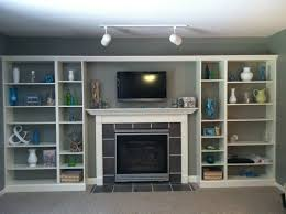 ikea built in bookcase open shelves around fireplace and tv of 15