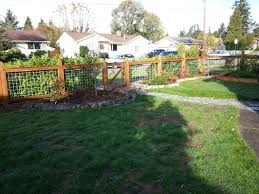 how to build a beautiful wood fence with hog wire