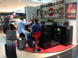 martini bar alphaomega runs a pop up bar in rome fiumicino celebrating martini