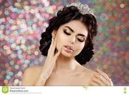 woman in lux dress crown queen princess lights party background