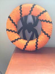 orange yarn hay wreath and a felt spider viola instant