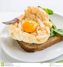 egg clouds breakfast with wholemeal bread toast and cloud egg stock image