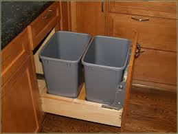 view in gallery double garbage cans hidden in white cabinetry