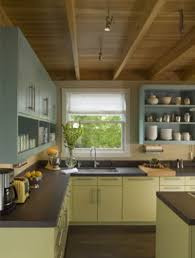 two tone kitchen cabinets brown 26 green kitchen cabinet ideas sebring design build