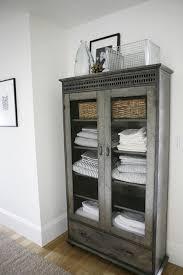 white linen cabinet with doors hallway features galvanized metal linen cabinet with glass doors