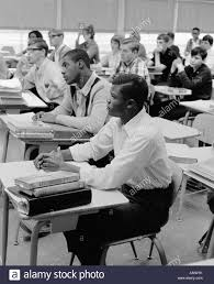 Desks For High School Students by 1960s Teen Boys Girls Racial Ethnic Mix Students Sit At Desks High