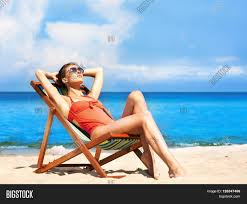 Chairs On A Beach Beautiful Seductive In Alluring Swimsuit Getting A Suntan