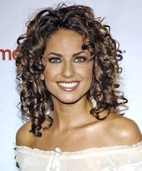 haircut that add height curly hairstyles to suit your face shape thehairstyler com