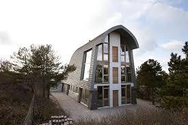 crazy little beach house emulates tall narrow sand dunes curbed