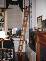 Rolling Ladder For Bookcase by 8 Clever Ways To Use A Rolling Library Ladder U2013 All Over The House