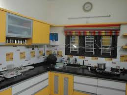 interior designer in indore colorful kitchen with window blinds design by chitra tibrewal