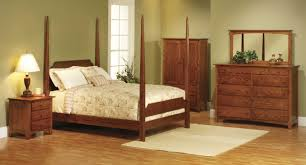 bed on the floor dark brown wooden carving dressing table on the floor connected by