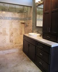 a travertine bath with a strip of glass mosaic as an accent