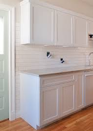 how to cut tile around cabinets setting the backsplash kitchen cabinet molding cabinet
