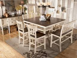 transitional breakfast room with bar height table white dining