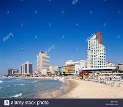 blocks of flats high rise buildings israel skyline beach seashore