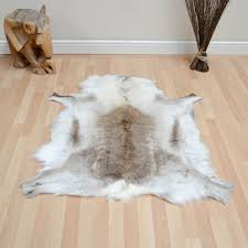 Laminate Floor Rugs Decorating Brilliant Faux Animal Skin Rugs With Sofas And Wooden