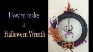 diy how to make a cute yarn halloween wreath decoration easy