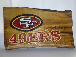 this san francisco 49ers sign is made using a reclaimed wood log