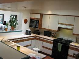 Resurfaced Kitchen Cabinets Before And After Kitchen Refinish Kitchen Cabinets And 49 N Hance Within