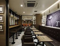 Small Shop Decoration Ideas Black Leather Armchair And Small Table For Amazing Coffee Shop