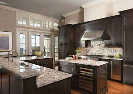 light colored granite countertops warm the kitchen with dark cabinets light countertops modern