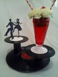 s centerpiece ideas  loved the centerpiece saddle shoes  with super cool daddio s sock hop custom handmade album record centerpieces   ebay from pinterestcom