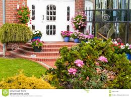 entrance in house with decoration of flowers stock photo image