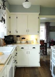 Cleaning Kitchen Cabinets Best Way by Painting Your Kitchen Cabinets White Best Way To Paint Your