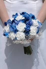 white and blue roses gorgeous white blue thistle hydrangea wedding bouquet