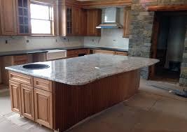 white kitchen cabinets with river white granite white granite