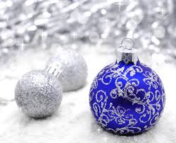 blue and silver balls on the snow isolated on white