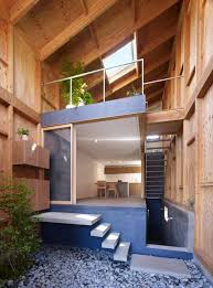 Wooden Structure House hang out on the roof inside the house