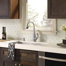white glass tile backsplash white countertop with dark wood