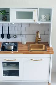 mini cuisine uip ikea see more of this great play kitchen makeover at babiekinsmag