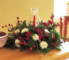 Christmas Hurricane Centerpiece - holiday floral centerpiece the florister