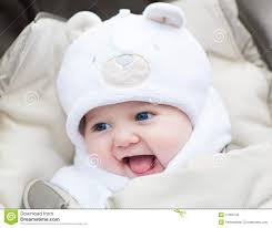 Laughing Baby Meme - funny laughing baby in a teddy bear hat in stroller stock photo