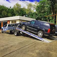 cadillac escalade towing handsome neil s towing handsomeneilstowing instagram photos