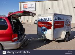 mpv van mpv van with u haul trailer attached in canada stock photo