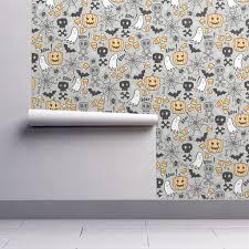 halloween doodle with skulls bat pumpkin spider web ghost on light