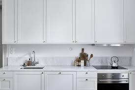 decordots simple framed kitchen cabinets with golden knob handles
