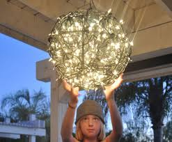 Diy Ball Chandelier Repurpose Flower Baskets Into A Glowing Outdoor Chandelier Club