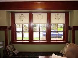 furniture three glass window with white roller shade window