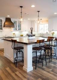 kitchen dining island white shaker waypoint cabinets designed by nathan hoffman