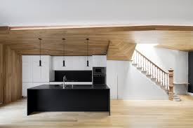 wooden surfaces connect living spaces nonagon style paul and sigi were looking to create a warm and welcoming space for their friends and family that often come to visit this town house in montreal was