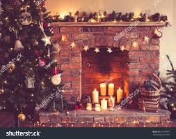decorated christmas tree front fireplace various stock photo