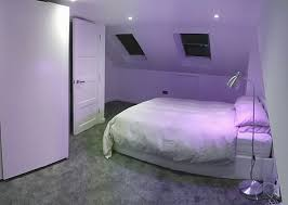 loft conversion with grey carpet and white bed from wayfair co uk