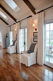 How To Hang Curtains On A Round Top Window Hgtv Dream Home 2015 Cozy Window And Living Rooms